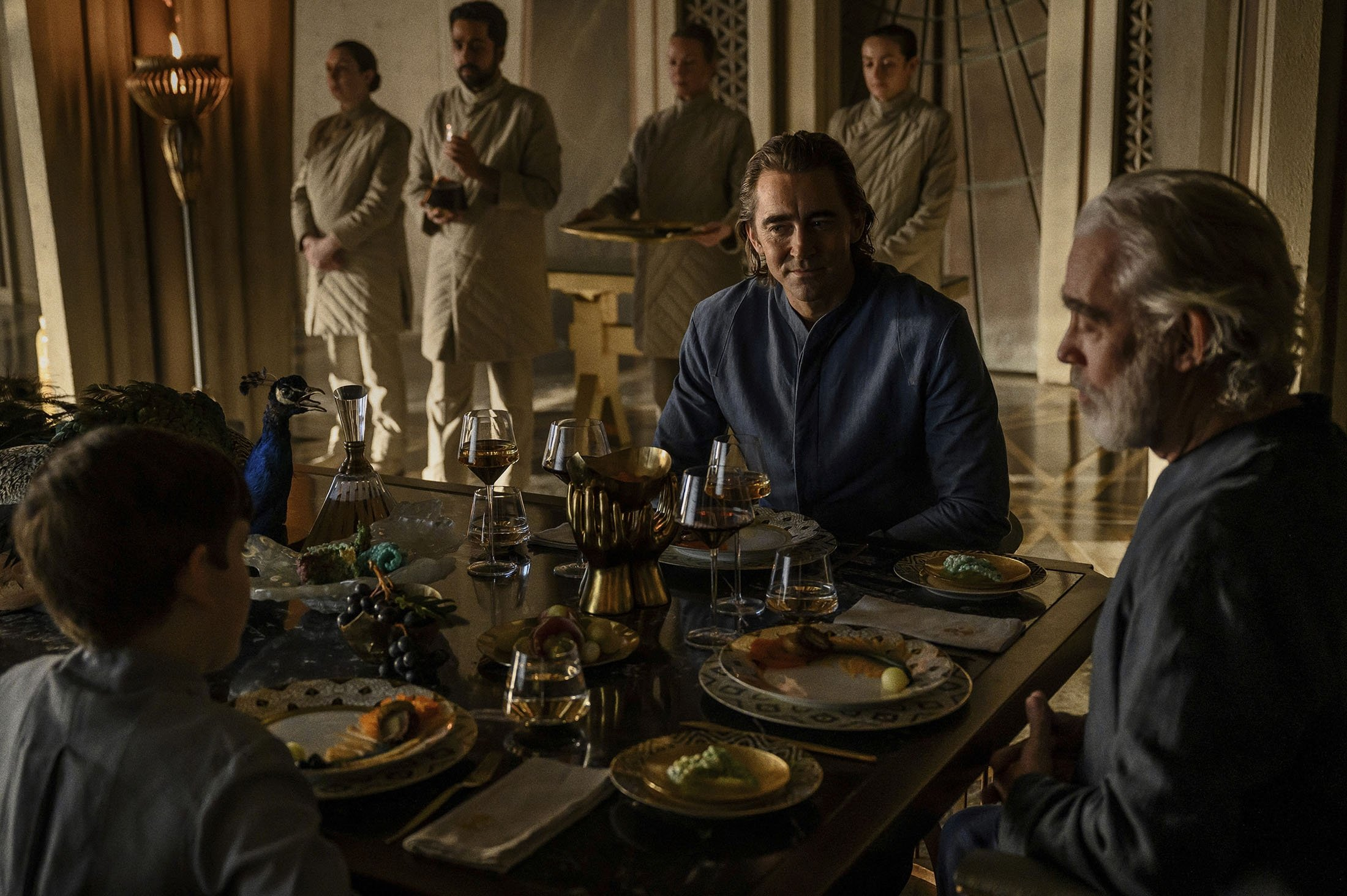 """Cooper Carter (L), Lee Pace (C) and Terrence Mann, in a scene from the series """"Foundation,"""" premiering Sept. 24, 2021. (Apple TV  via AP)"""