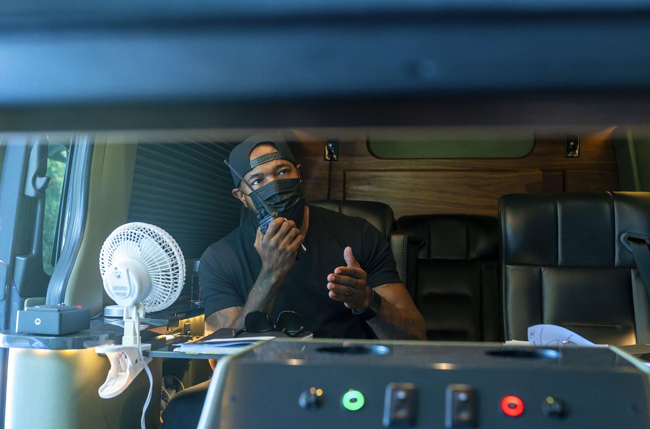 Director Antoine Fuqua works from a vehicle on the set of 'The Guilty.' (Netflix via AP)