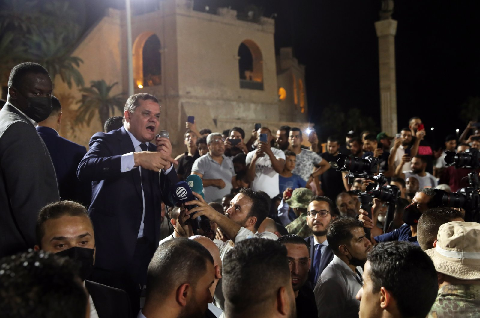 Libyan Prime Minister Abdul Hamid Mohammed Dbeibah (C) addresses a crowd of his supporters in Martyrs Square in Tripoli, Libya, Sept. 21, 2021. (EPA Photo)