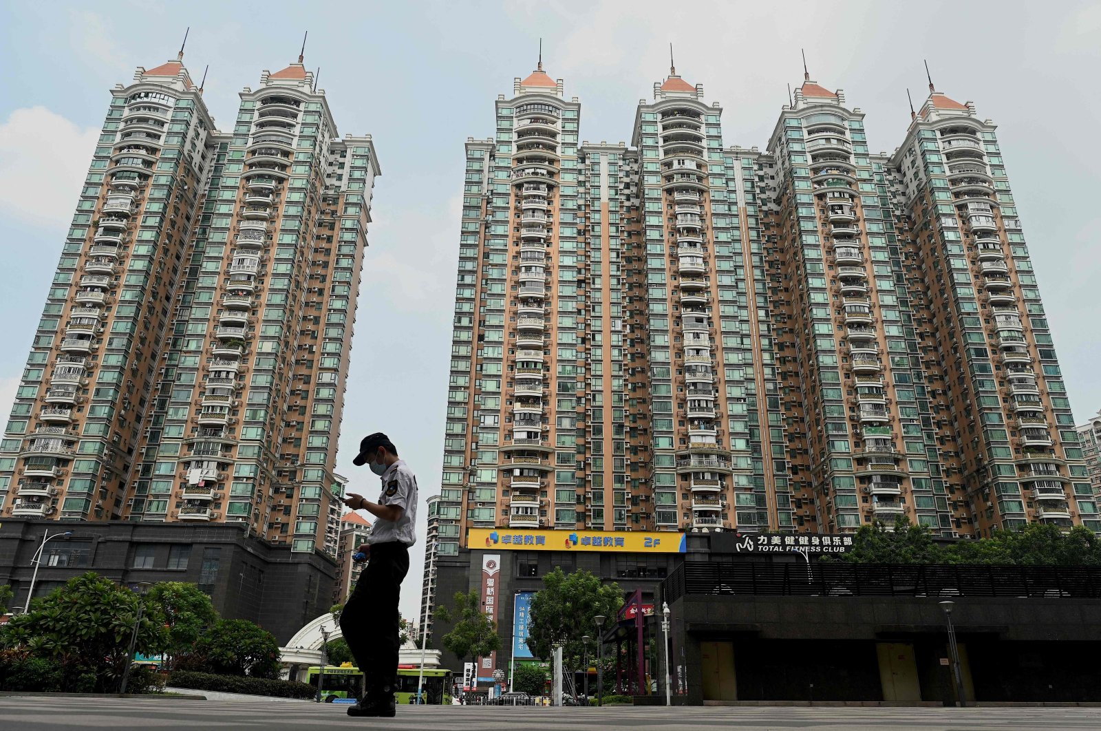 A man walks past a housing complex by Chinese property developer Evergrande in Guangzhou, in China's southern Guangdong province, Sept. 17, 2021. (AFP Photo)