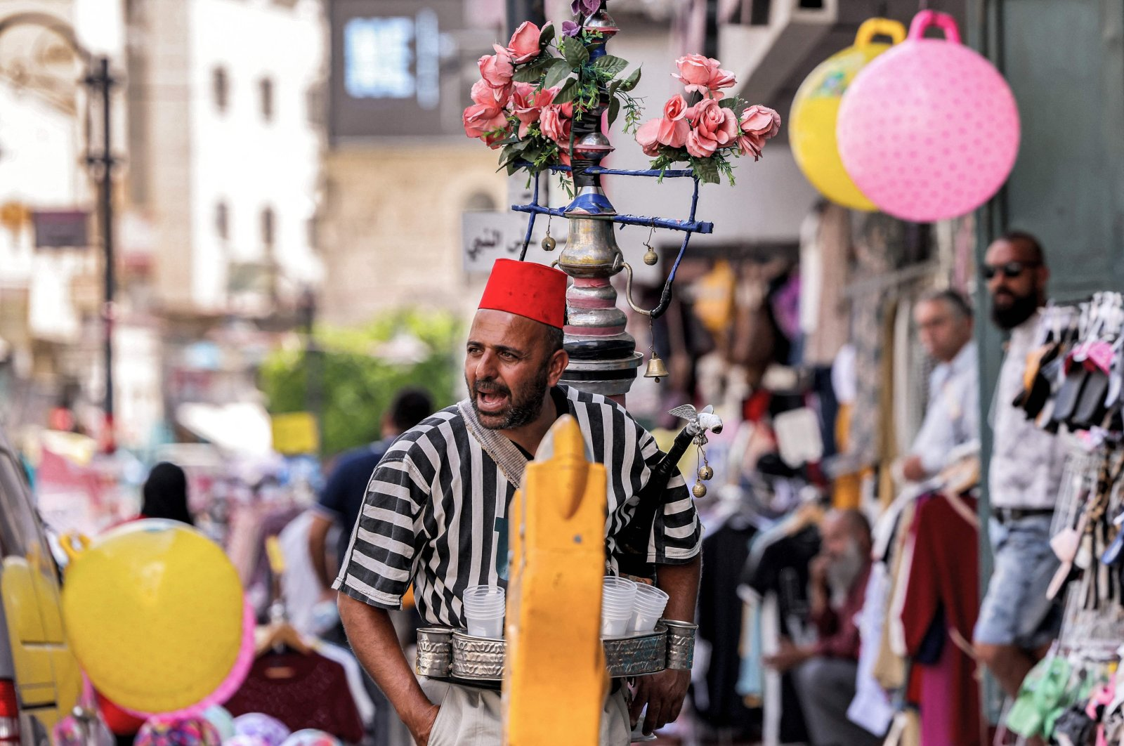 A Palestinian fresh juice street vendor calls for customers at a market in the old city of Bethlehem in the Israeli-occupied West Bank, Sept. 14, 2021. (AFP Photo)