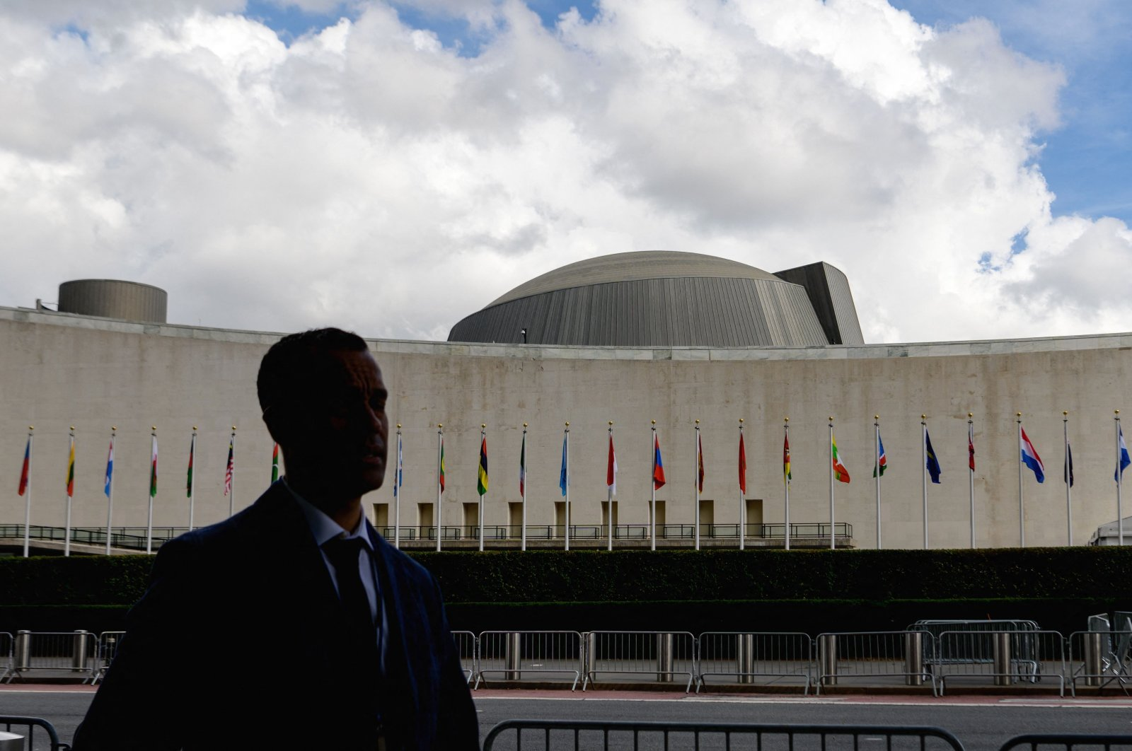 A man walks past the United Nations headquarters during the 76th Session of the U.N. General Assembly in New York City, U.S., Sept. 21, 2021. (AFP Photo)