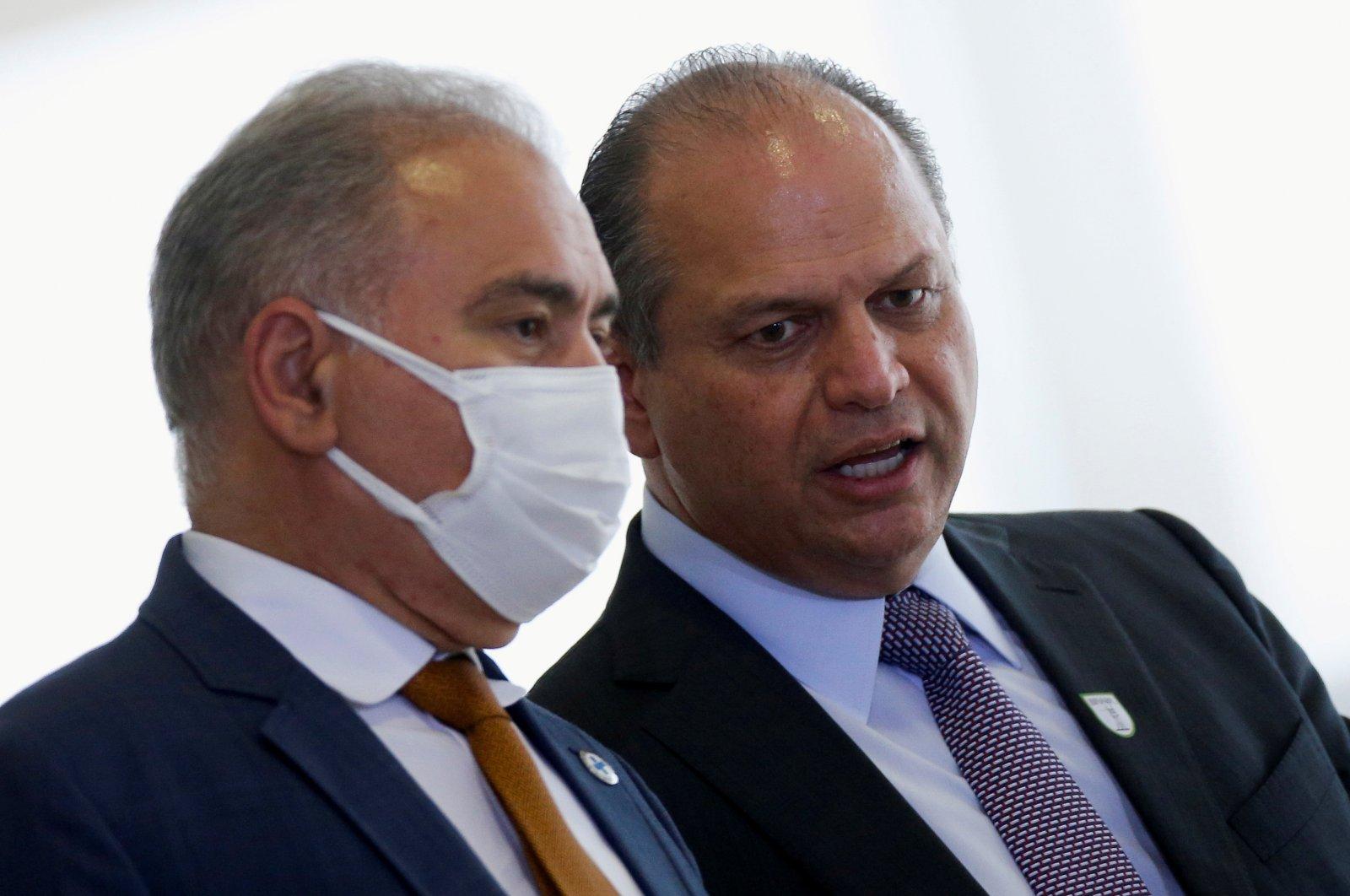 Brazil's Health Minister Marcelo Queiroga (L) talks with Brazilian Deputy Ricardo Barros (R) before a ceremony at the Planalto Palace in Brasilia, Brazil, Sept. 14, 2021. (Reuters Photo)