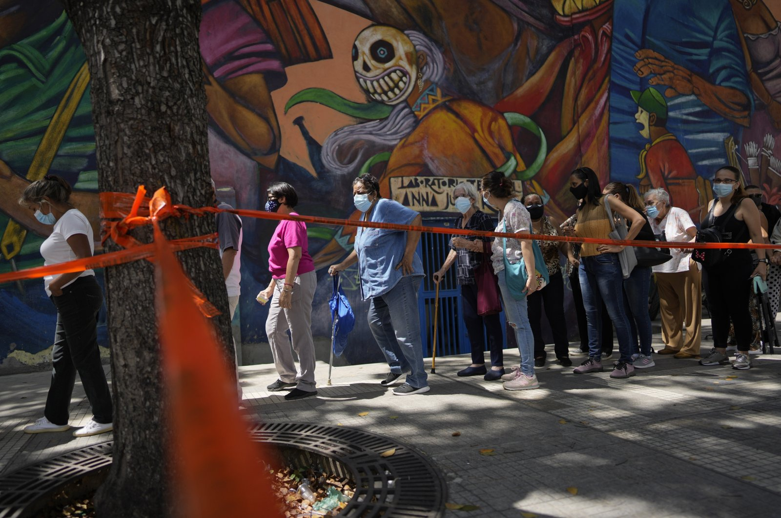 Residents stand in line to be injected with a second dose of the Sputnik V COVID-19 vaccine after more than a three-month delay, in Caracas, Venezuela, Sept. 21, 2021. (AP Photo)