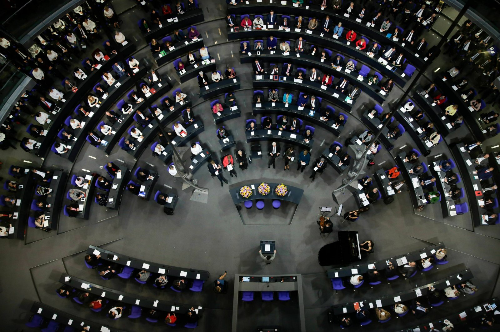German lawmakers attend a special parliament session at the Reichstag building, host of the German federal parliament, Bundestag, to celebrate 100 years of women's suffrage in Germany, Berlin, Germany, Jan. 17, 2019. (AP Photo)