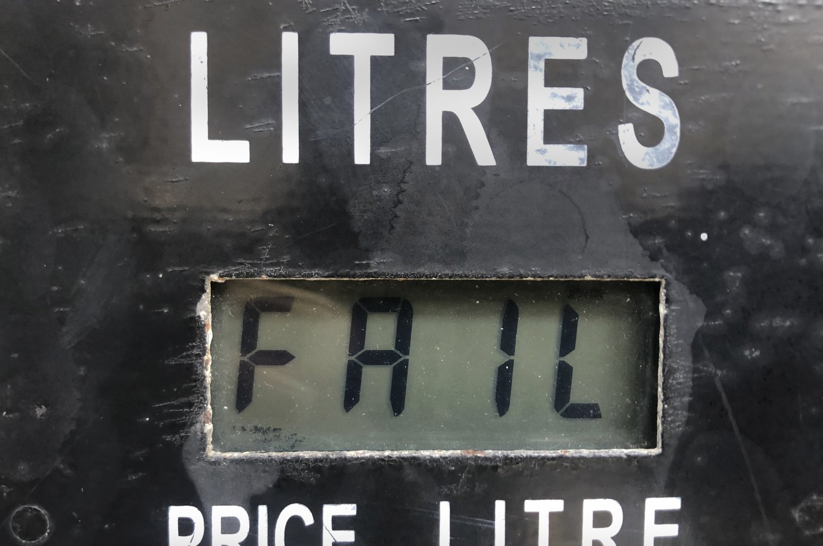 """A screen on a gasoline pump reads, """"Fail,"""" after the latest increase in fuel prices with most meters unable to accommodate the new five digit price for one liter of gas, in Beirut, Lebanon, Sept. 22, 2021. (AP Photo)"""