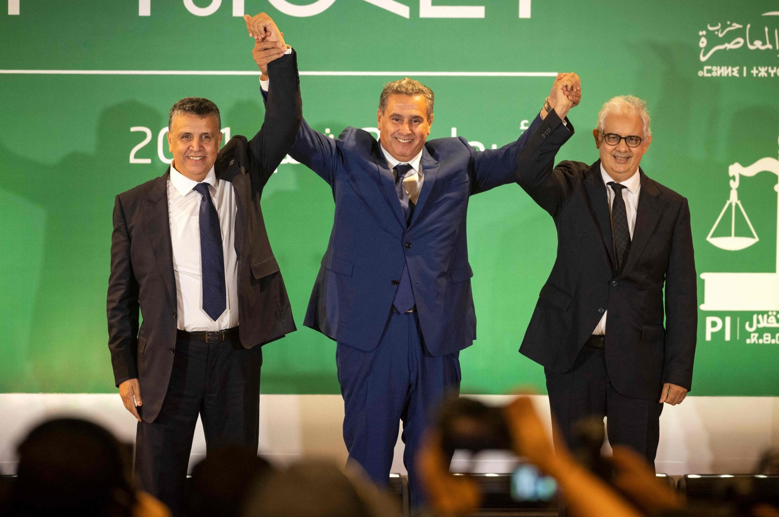 Morocco's prime minister-designate Aziz Akhannouch (C), Abdellatif Ouahbi (L), president of Morocco's Authenticity and Modernity Party (PAM), and Nizar Baraka (R), president of the Istiqlal Party (R), after Akhannouch announced a coalition of RNI, PAM and Istiqlal, Rabat, Morocco, Sept. 22, 2021. (AFP Photo)