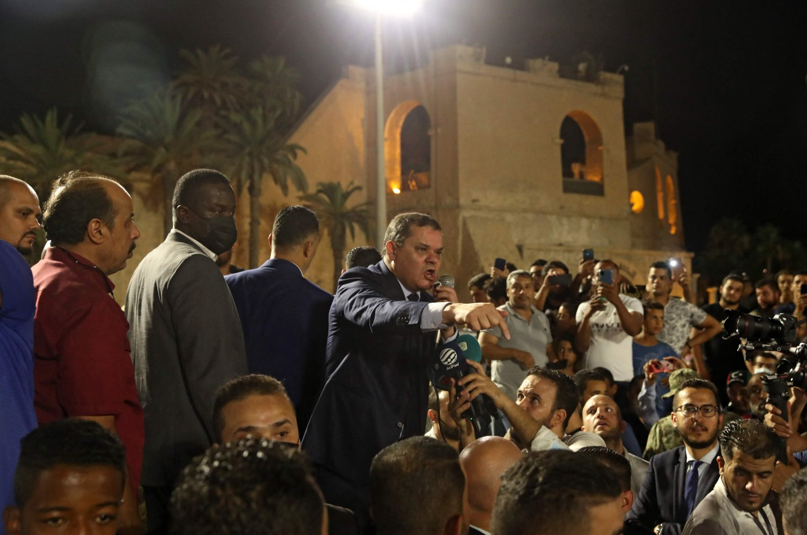 Libya's interim Prime Minister Abdulhamid Dbeibah greets a crowd in Tripoli's Martyrs' Square on September 21, 2021. (AFP Photo)