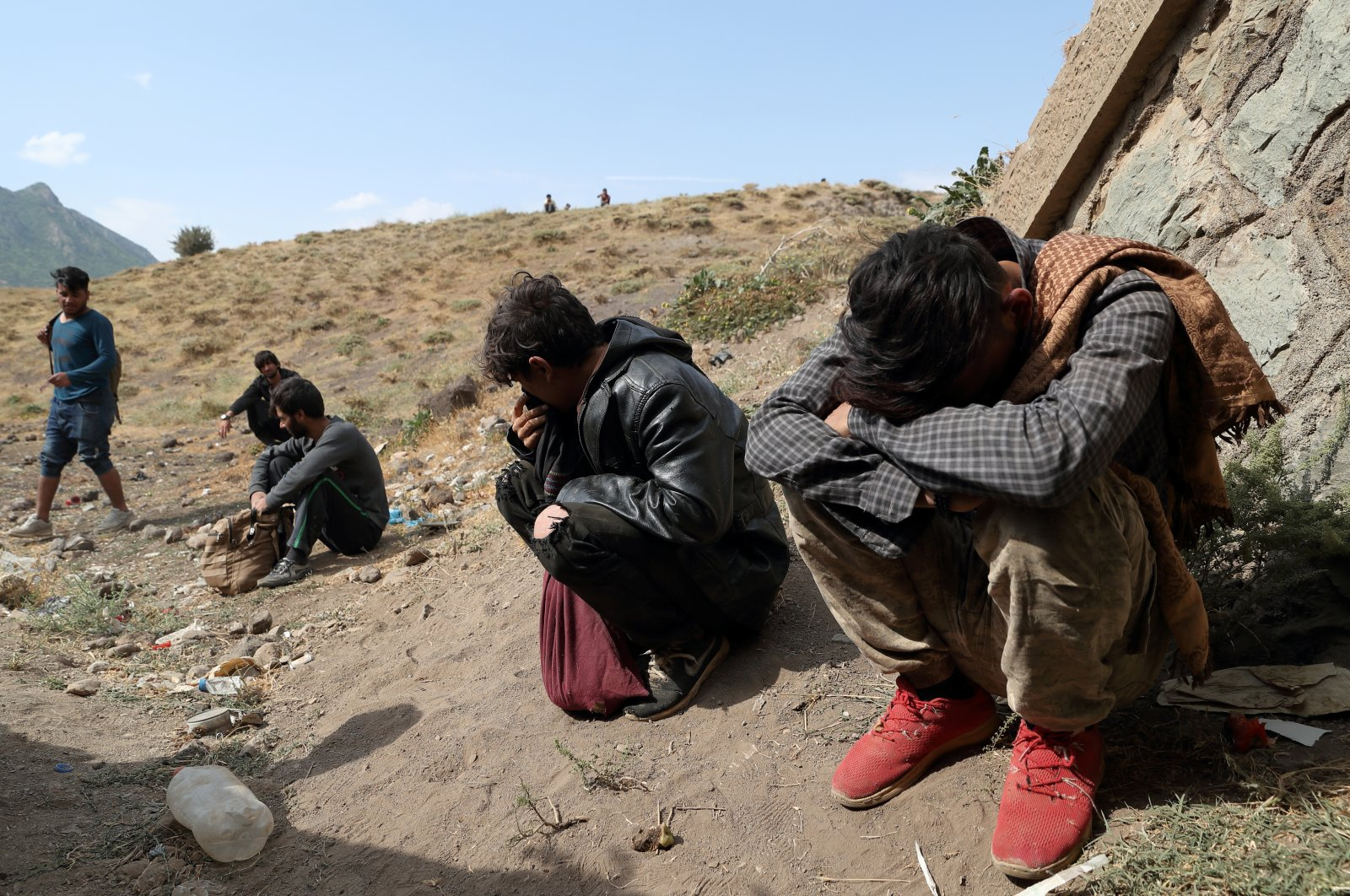 Afghan migrants hide from security forces after crossing illegally into Turkey from Iran, near Tatvan in Bitlis province, Turkey, Aug. 23, 2021. (REUTERS Photo)