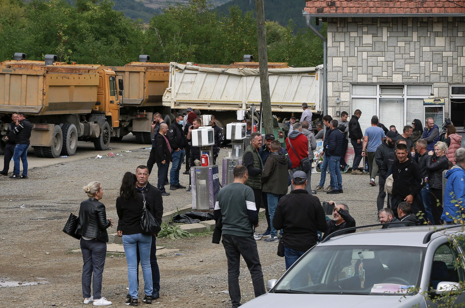 Local Serbs stand beside a road blocking the road leading to the northern Kosovo border crossing of Jarinje, Sept. 21, 2021. (AP Photo)