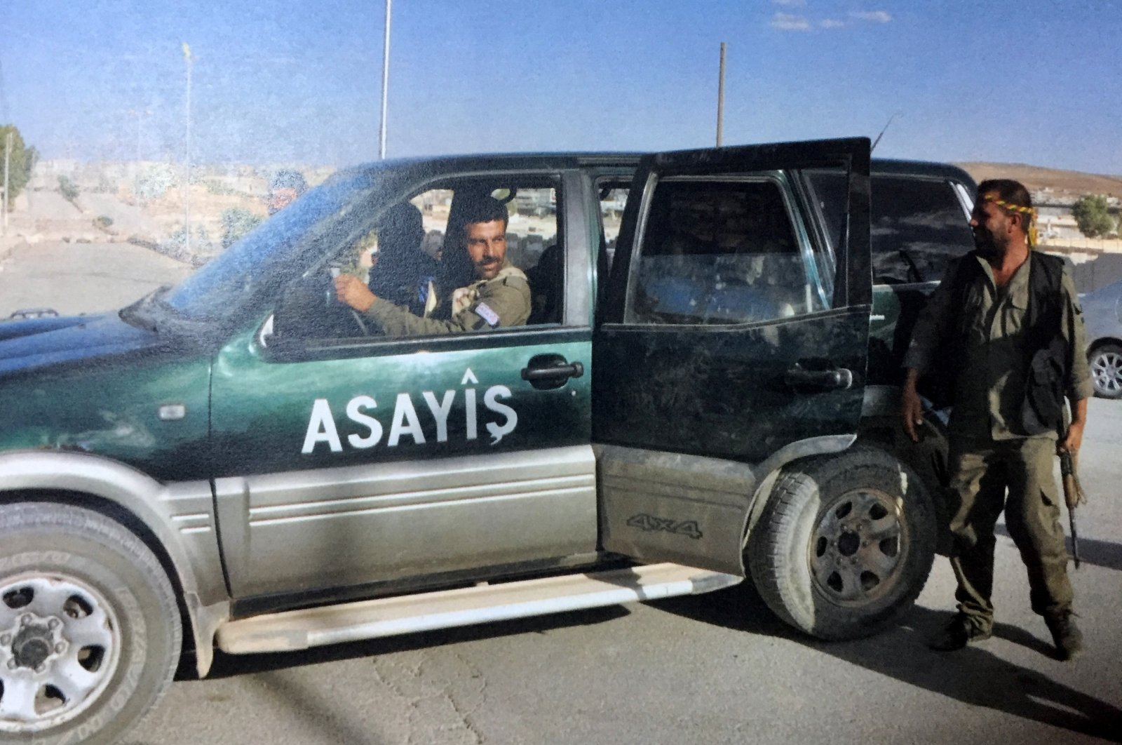 YPG terrorists are seen during a patrol in this undated file photo. (IHA Photo)