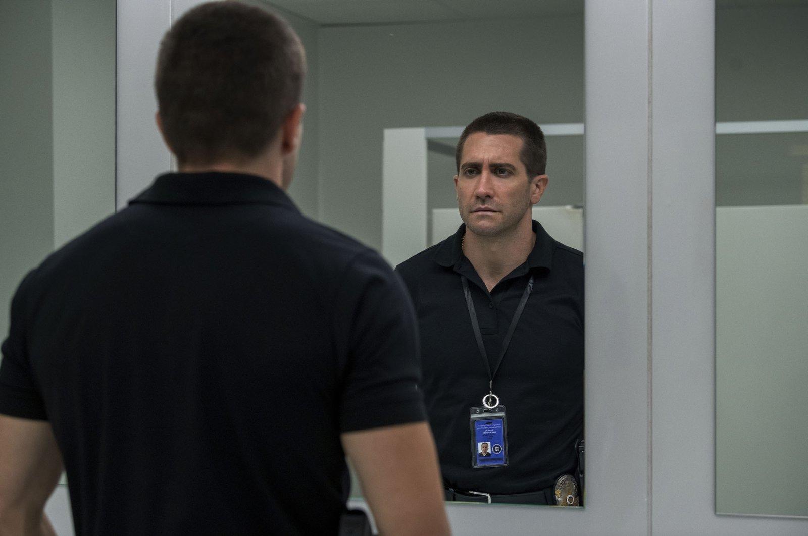 "Jake Gyllenhaal, in a scene from the film ""The Guilty."" (Netflix via AP)"