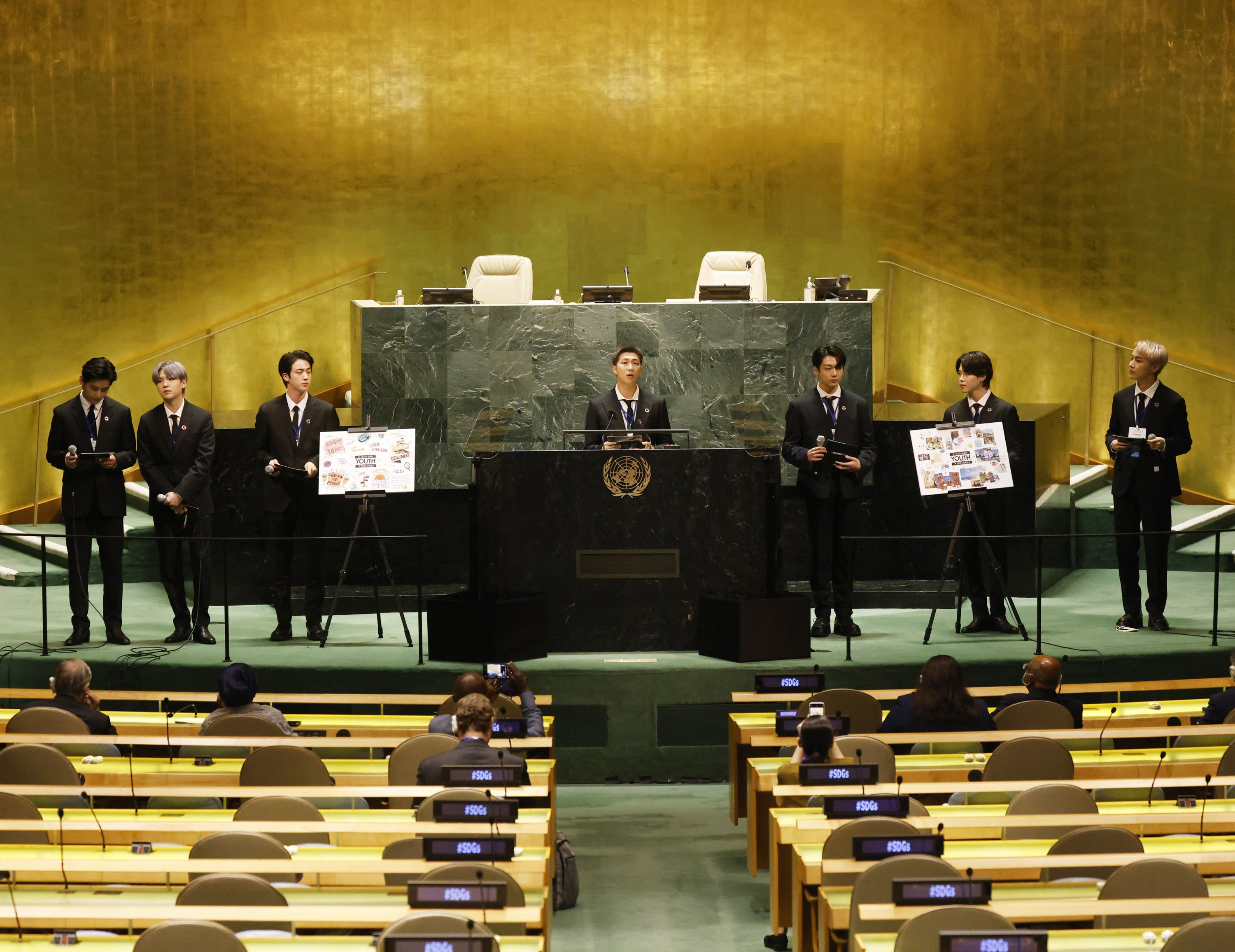 Members of the South Korean K-pop band BTS appear at the Sustainable Development Goals meeting during the 76th session of the United Nations General Assembly at the U.N. Headquarters on Monday, Sept. 20, 2021. (John Angelillo/Pool Photo via AP)