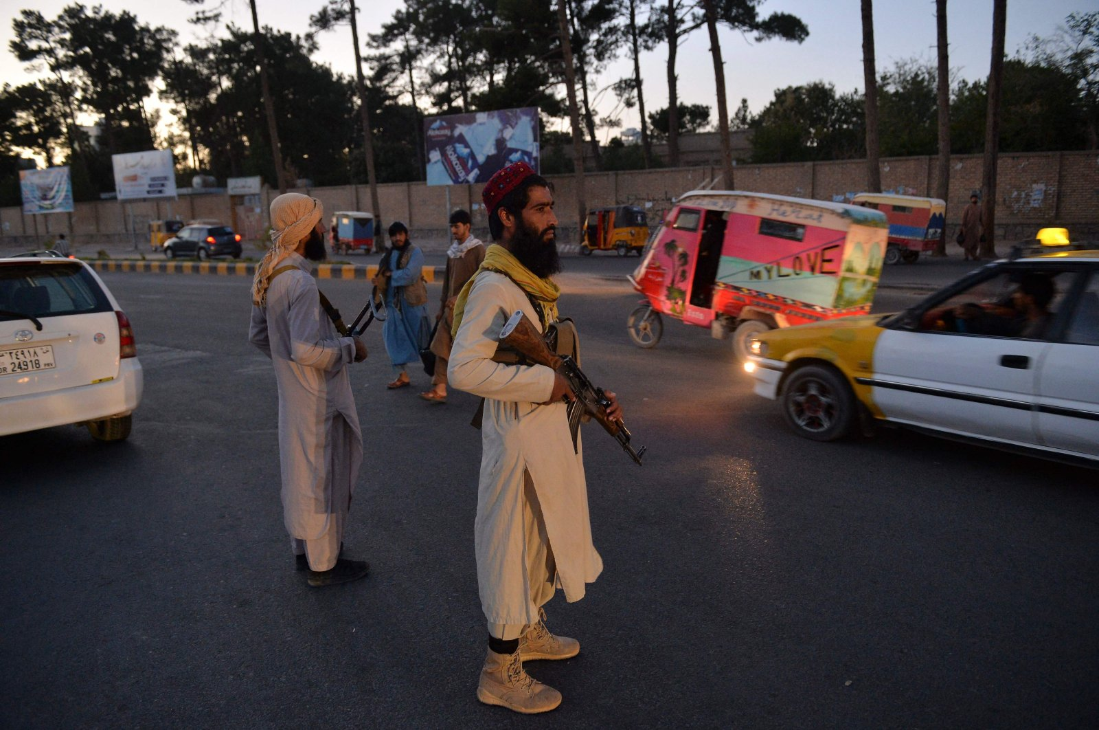 Taliban fighters stand guard along a road in Herat, Afghanistan, Sept. 21, 2021. (Photo by Hoshang Hashimi / AFP)