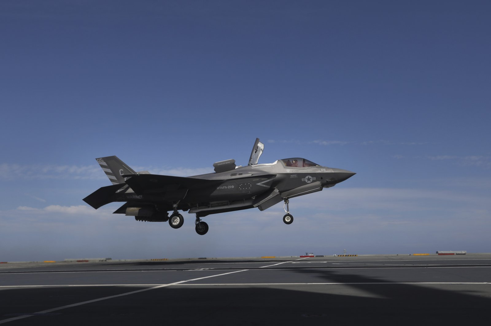A pilot maneuvers an F-35 jet as military personnel participate in the NATO Steadfast Defender 2021 exercise on the aircraft carrier HMS Queen Elizabeth off the coast of Portugal, May 27, 2021. (AP Photo)