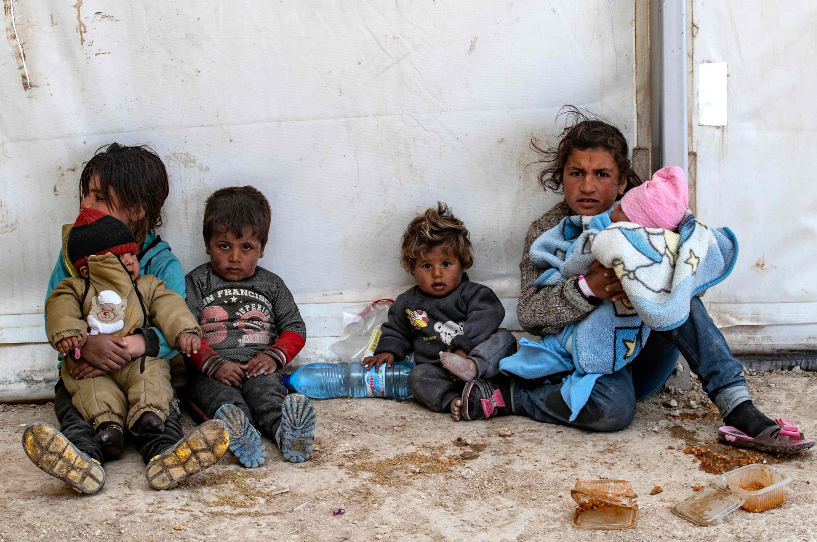 Syrian children sitting at the PKK/YPG terrorist group-run al-Hol camp which holds suspected relatives of Daesh terrorist group fighters, in Hasakeh governorate of northeastern Syria, March 18, 2021. (AFP File Photo)