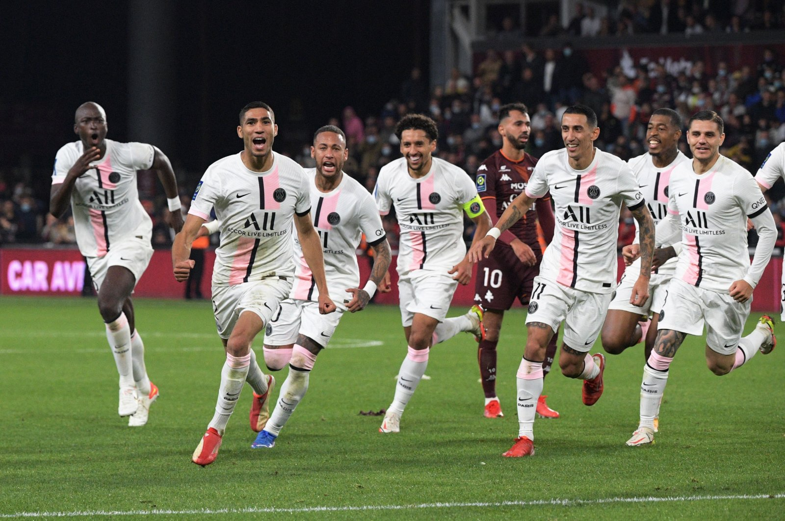 Paris Saint-Germain's Moroccan defender Achraf Hakimi (2nd L) celebrates with teammates after scoring his team's second goal during a Ligue 1 match between FC Metz in Longeville-les-Metz, eastern France, Sept. 22, 2021. (AFP Photo)