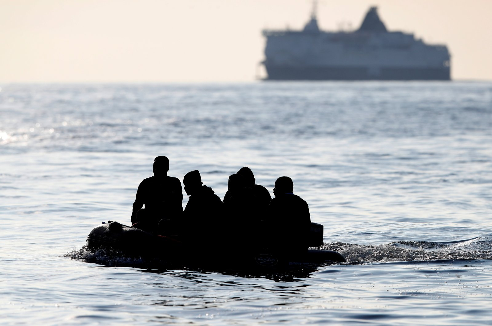People who say they are from Darfur, Sudan cross the English Channel in an inflatable boat near Dover, Britain, Aug. 4, 2021. (Reuters Photo)
