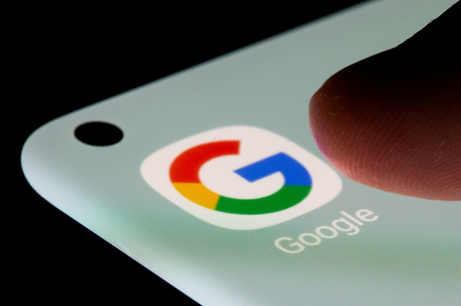 The Google app is seen on a smartphone in this illustration taken, July 13, 2021. (Reuters Photo)