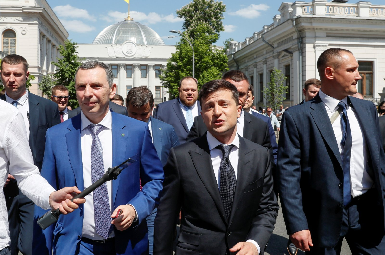 Ukraine's President Volodymyr Zelenskyy, accompanied by his aide Serhiy Shefir, other officials and bodyguards, walks from Parliament to the presidential administration office, after his inauguration, Kyiv, Ukraine, May 20, 2019. (Reuters Photo)