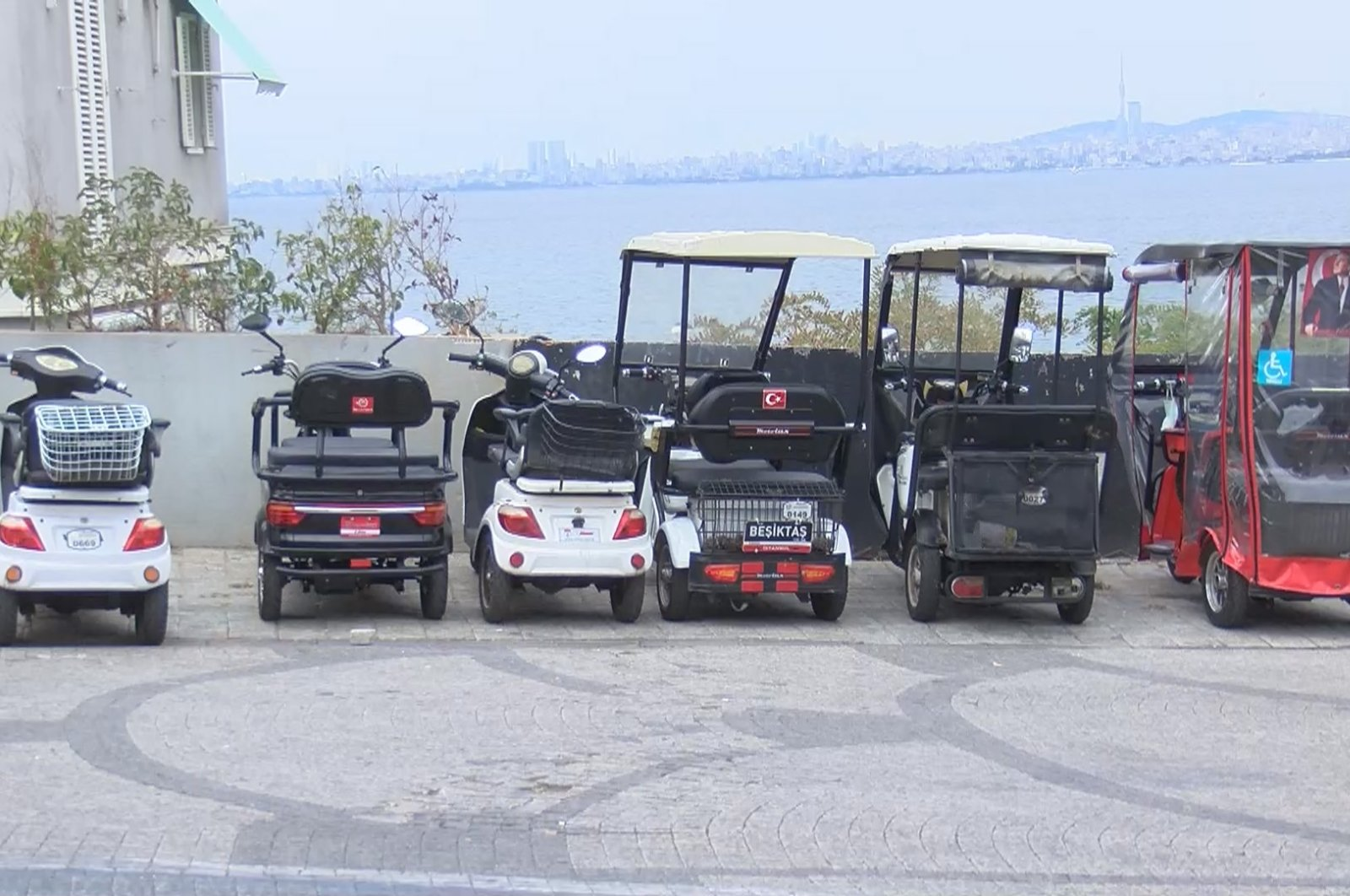A view of battery electric vehicles parked in Büyükada, in Istanbul, Turkey, Sept. 23, 2021. (DHA Photo)