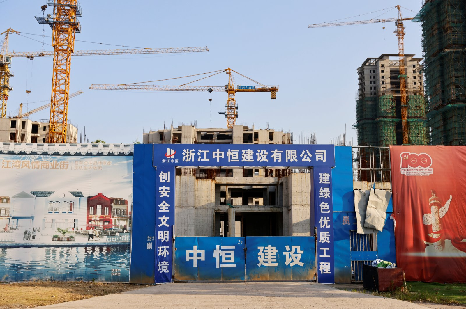 Cranes stand at the construction site of Evergrande Cultural Tourism City, a project developed by China Evergrande Group, in Suzhou's Taicang, Jiangsu province, China, Sept. 23, 2021. (Reuters Photo)
