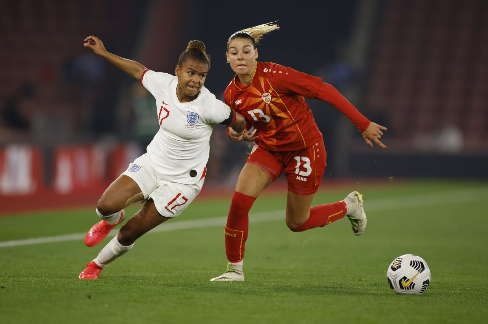 England's Nikita Parris (L) in action with North Macedonia's Julija Zivikj during a women's World Cup UEFA qualifiers at St. Mary's Stadium, Southampton, Britain, Sept. 17, 2021. (Reuters Photo)