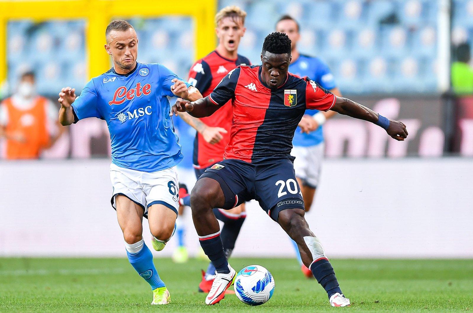 Napoli's Stanislav Lobotka (L) in action against Genoa's Caleb Ekuban (R) during a Serie A match at Luigi Ferraris stadium, Genoa, Italy, Aug. 29, 2021. (EPA Photo)