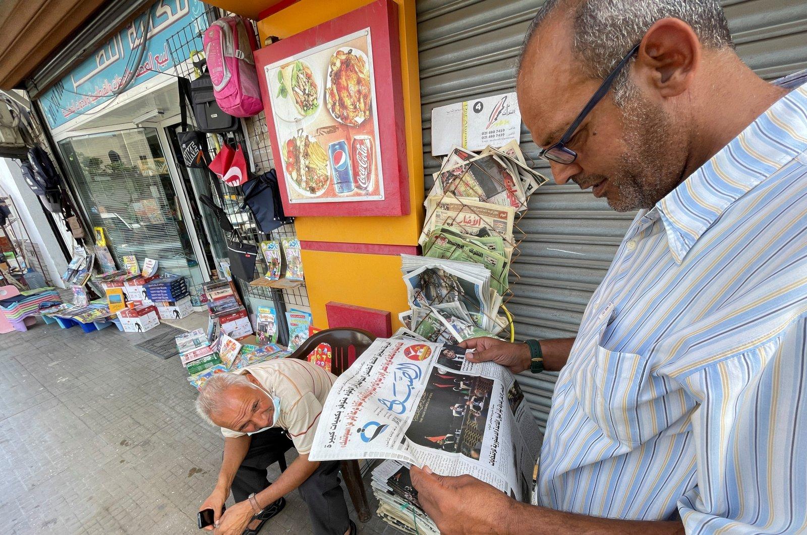 A man reads a newspaper in Tripoli, Libya, September 22, 2021. (REUTERS Photo)