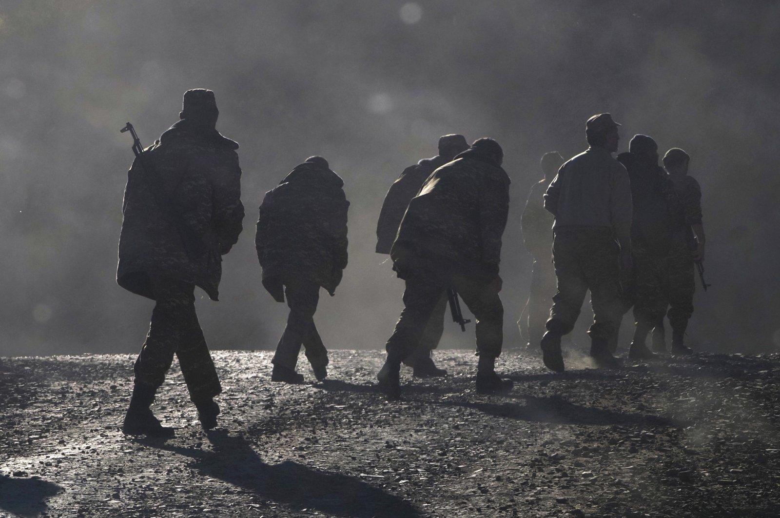 Armenian soldiers walk along the road near the border between Nagorno-Karabakh and Armenia, Nov. 8, 2020. (AP Photo)