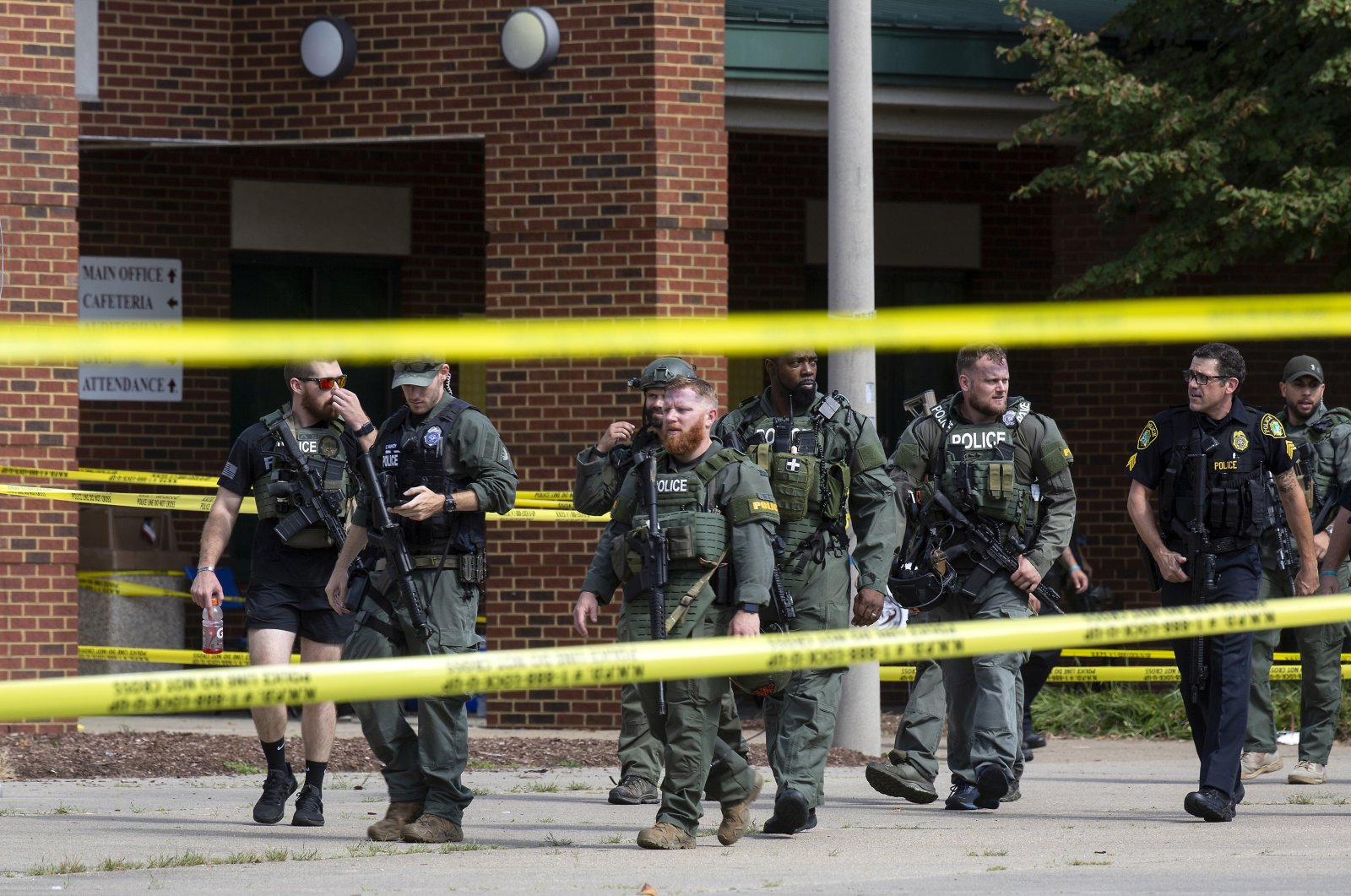 Law enforcement officers exit Heritage High School while responding to a shooting, in Newport News, Virginia, Sept. 20, 2021. (The Virginian-Pilot via AP, File Photo)