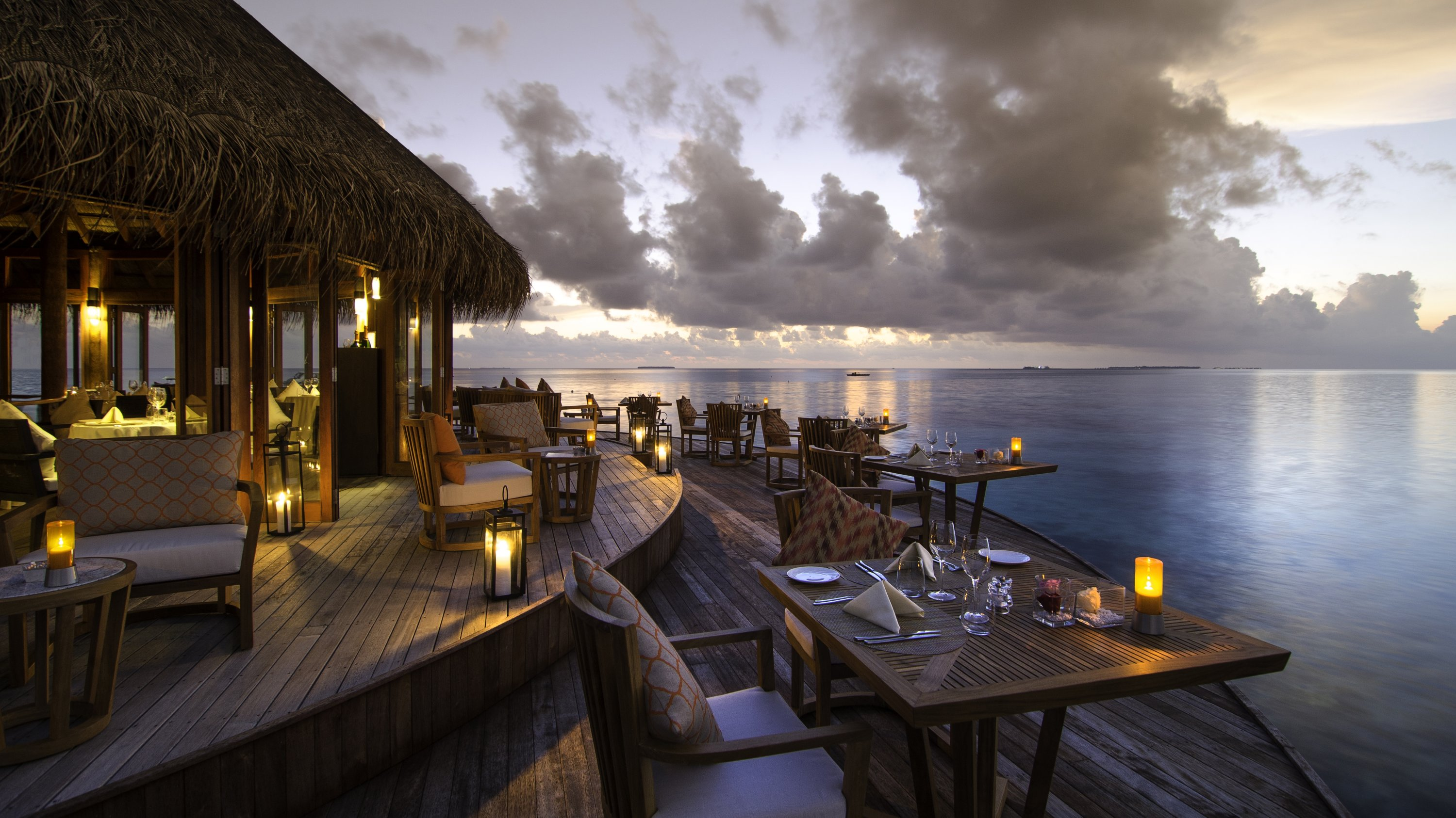 Don't be surprised to see stingrays or schools of fish lazily swimming as you enjoy culinary delights with an incredible view at Mirihi's Muraka restaurant. (Photo courtesy of Mirihi Maldives)