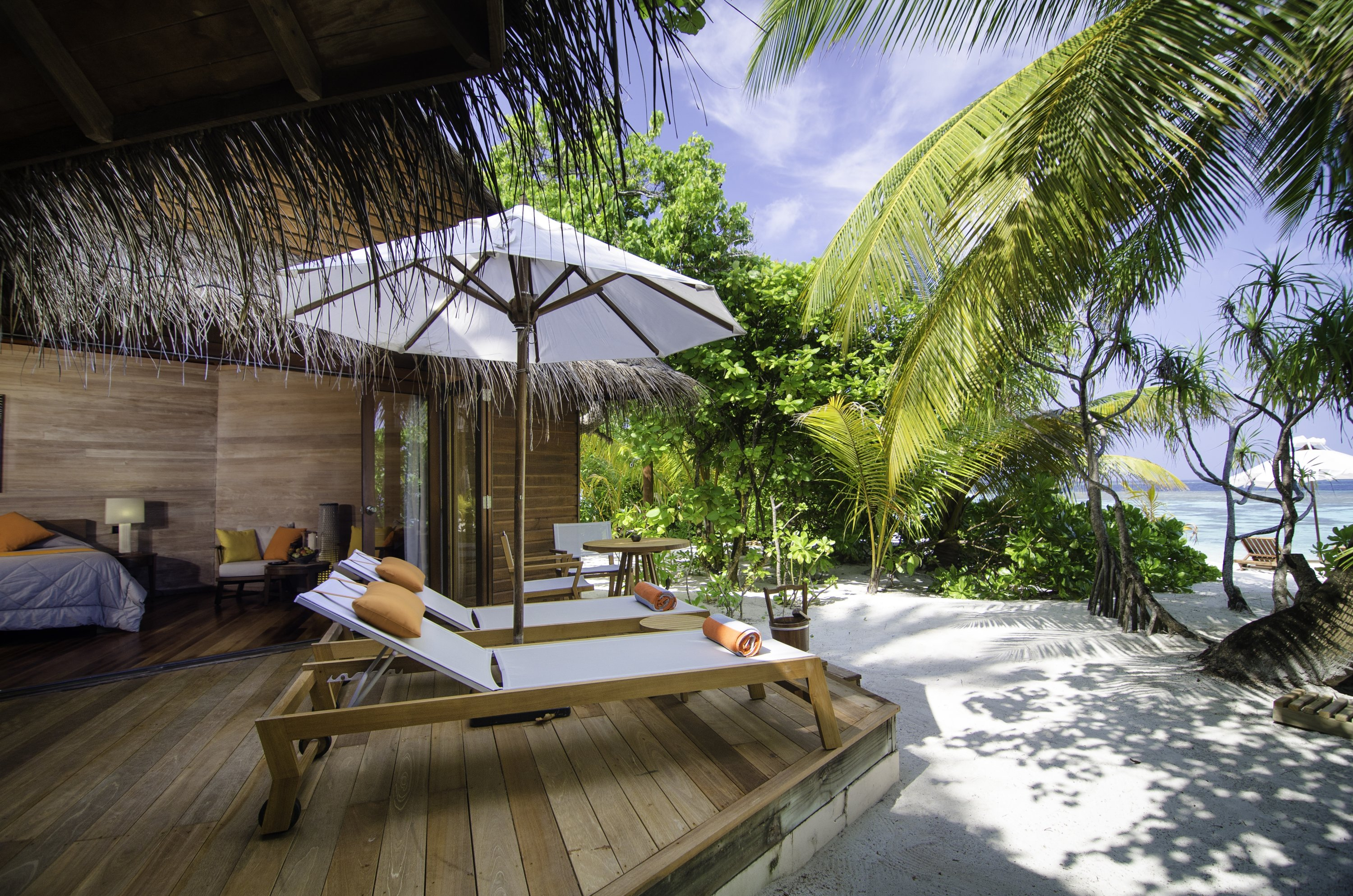 Tucked between palm trees, Mirihi's beach villas offer privacy while being just a few steps away from the sea. (Photo courtesy of Mirihi Maldives)