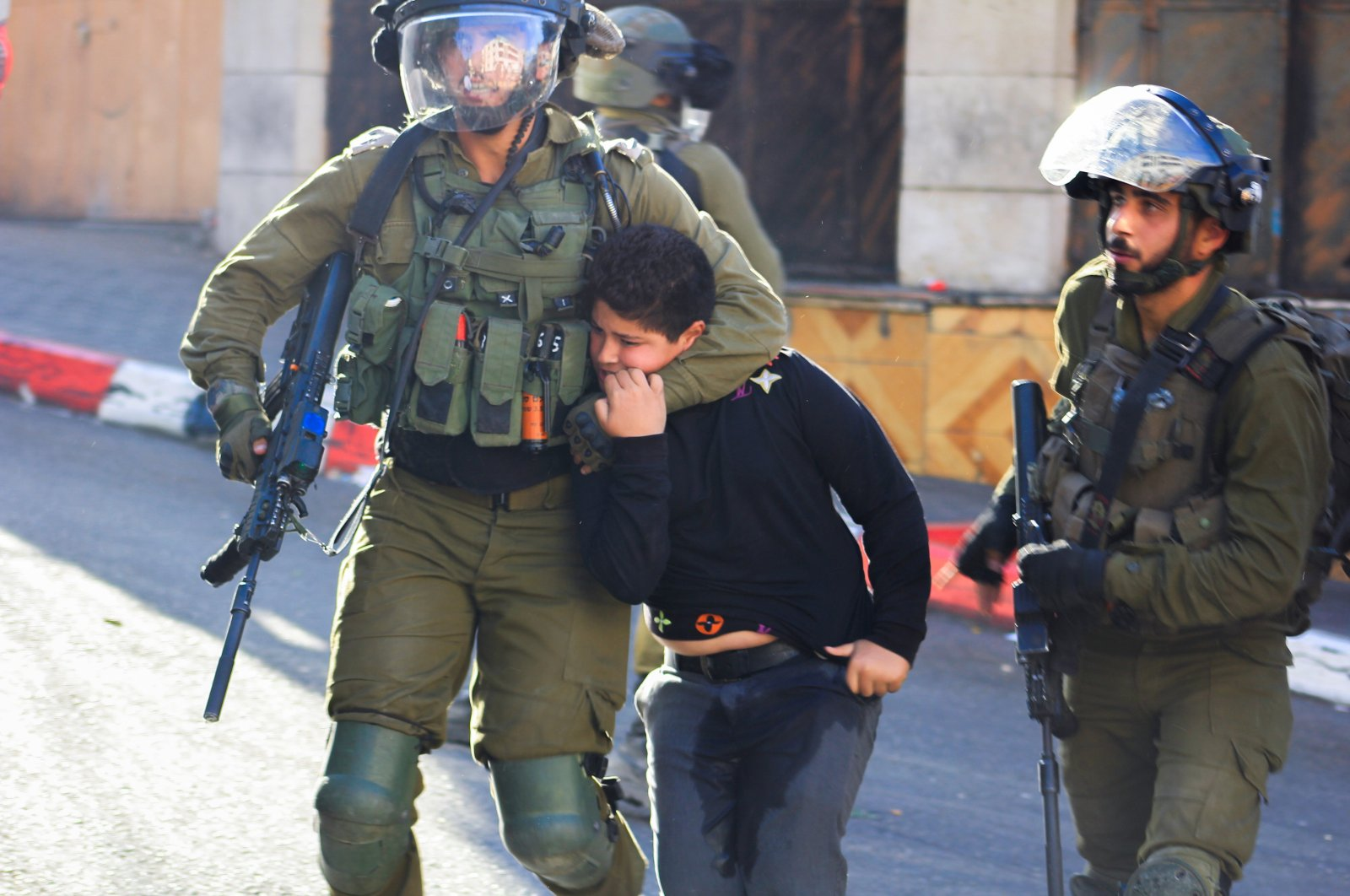 Israeli soldiers detain a Palestinian boy, in Hebron, Israeli-occupied West Bank, Sept. 23, 2021. (Reuters Photo)