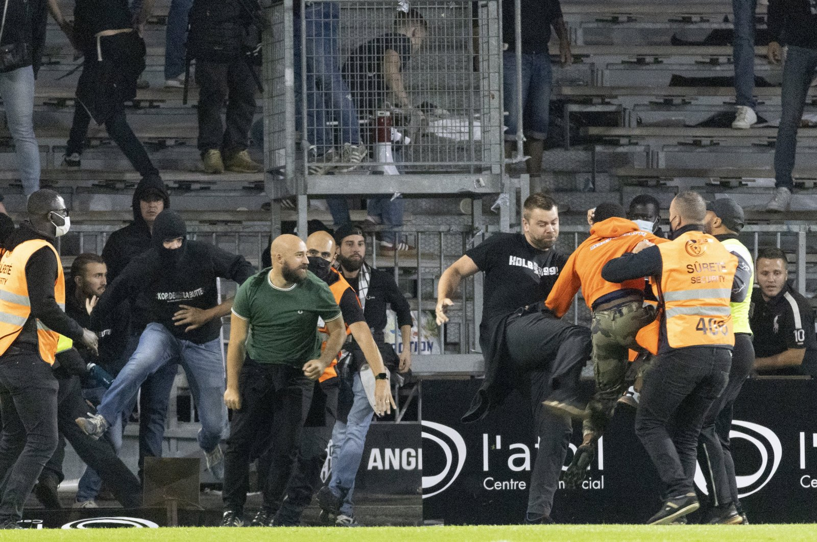 Football supporters clash as angry Marseille supporters invade the field after the Angers-Marseille match, in Angers, France, Sept. 22, 2021. (AP Photo)