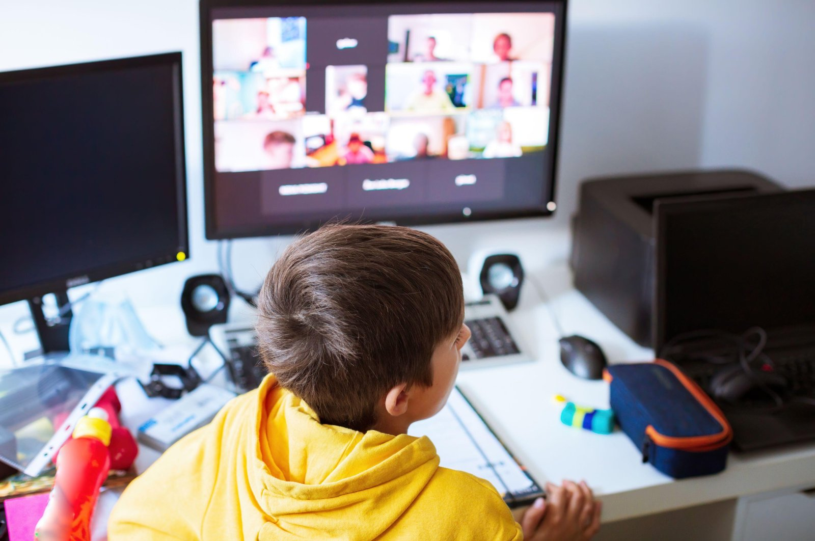 A child attends remote lessons on a computer. (Alamy Photo)