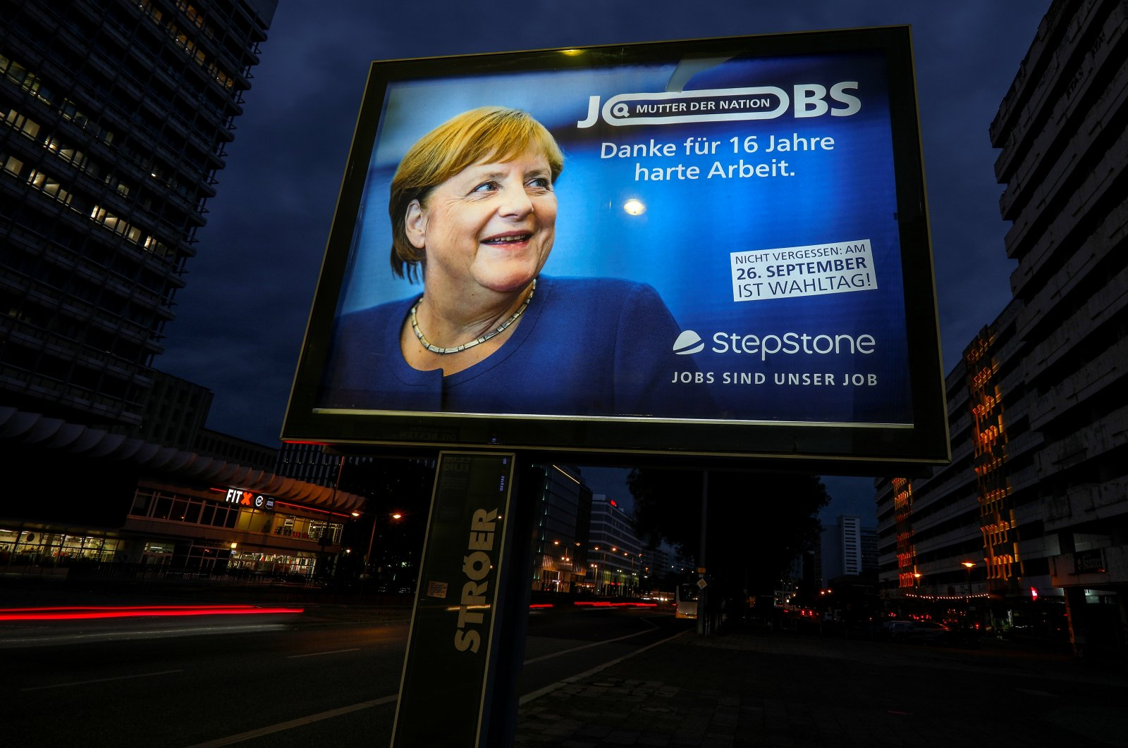 """A poster with a picture of Chancellor Angela Merkel that reads """"Mother of the nation. Thank you for 16 years of hard work,"""" is seen before the general elections in Berlin, Germany, Sept. 23, 2021. (Reuters Photo)"""