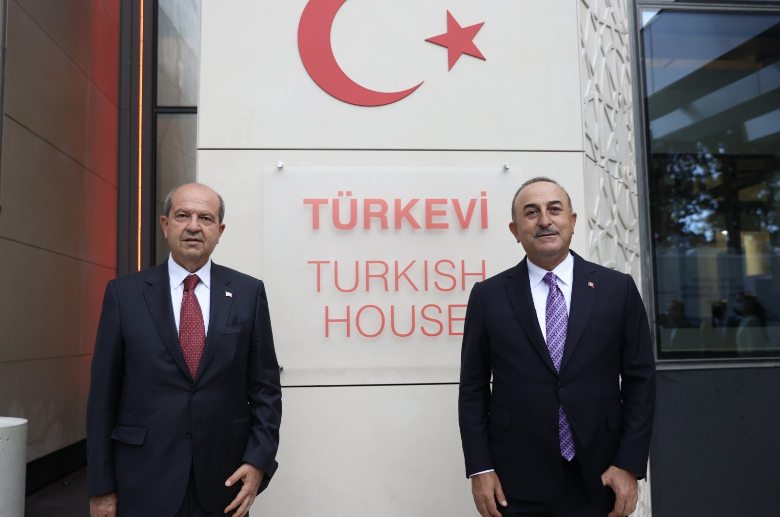 Turkey's Foreign Minister Mevlüt Çavuşoğlu and Turkish Cypriot President Ersin Tatar are seen in front of the Turkish House (Türkevi) in New York, U.S., Sept. 24, 2021. (AA Photo)
