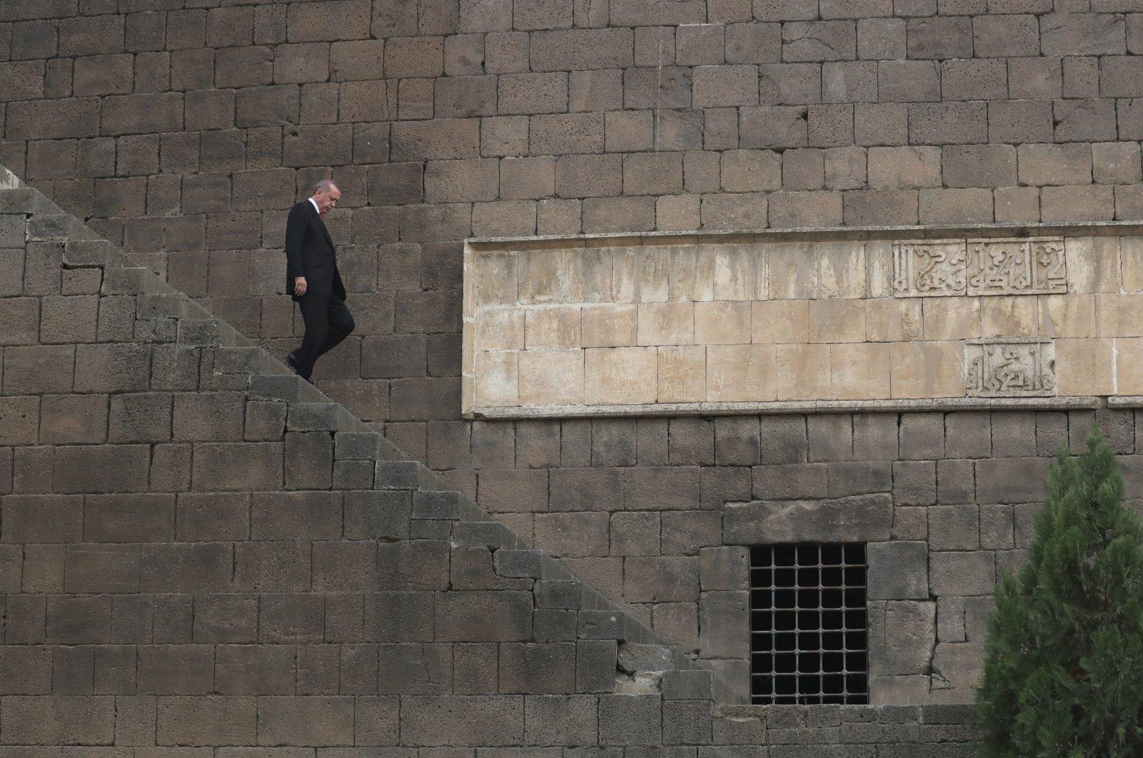 President Recep Tayyip Erdoğan visits the historical walls surrounding the old city of Diyarbakır, in Turkey's predominantly Kurdish southeast, Oct. 20, 2018. (AP Photo)