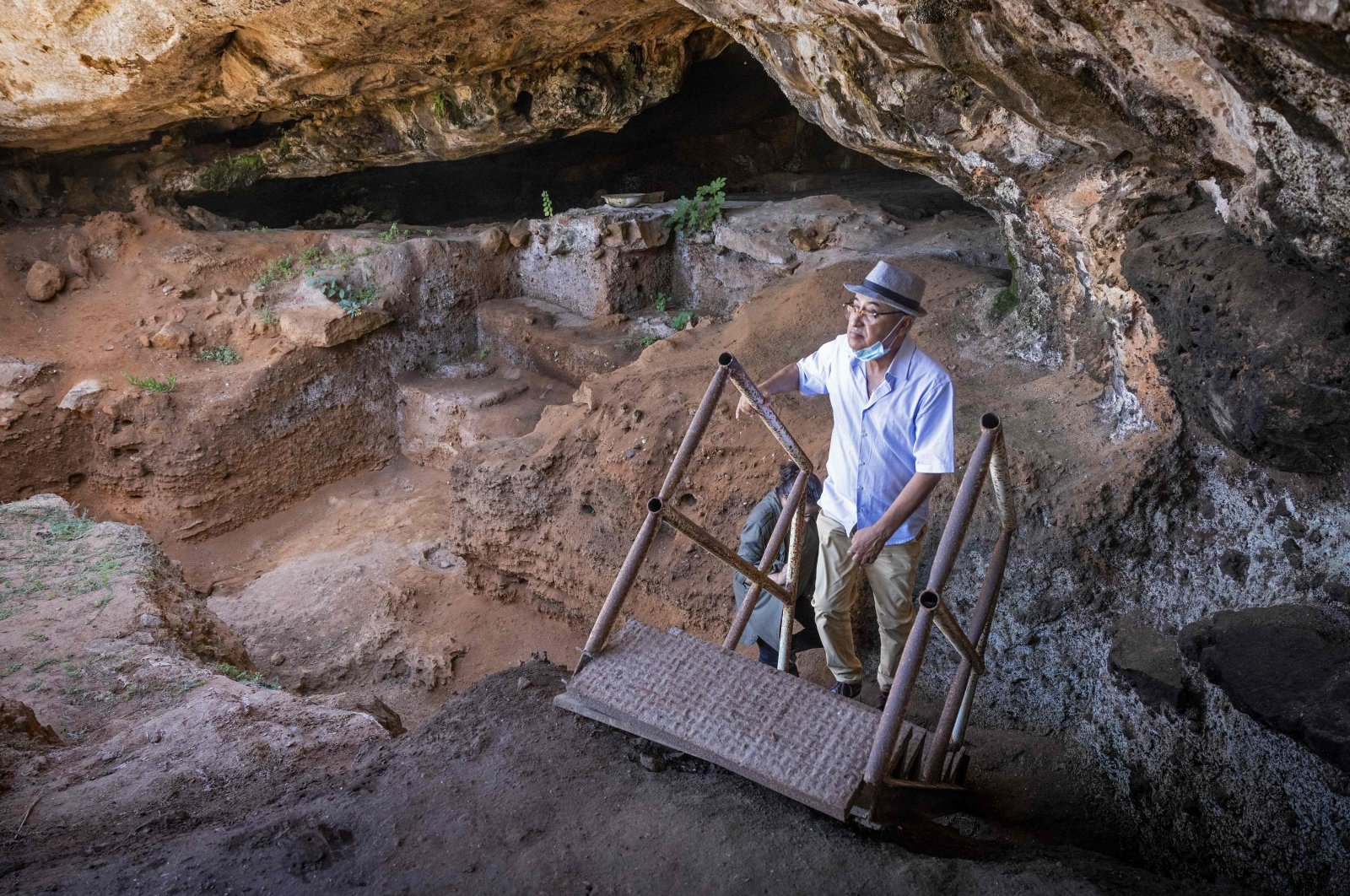 Archeologists walk to enter the Contrebandiers (Smugglers) Cave less than 20 kilometers from the Moroccan capital Rabat, Sept. 18, 2021. (AFP Photo)