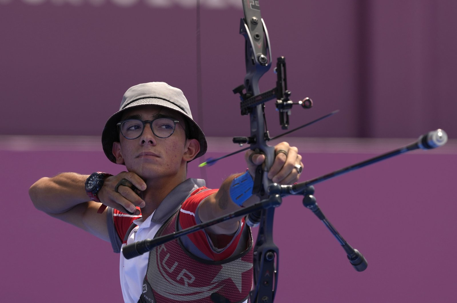 Turkey's Mete Gazoz shoots an arrow during the individual eliminations at the 2020 Summer Olympics, in Tokyo, Japan, July 29, 2021. (AP Photo)