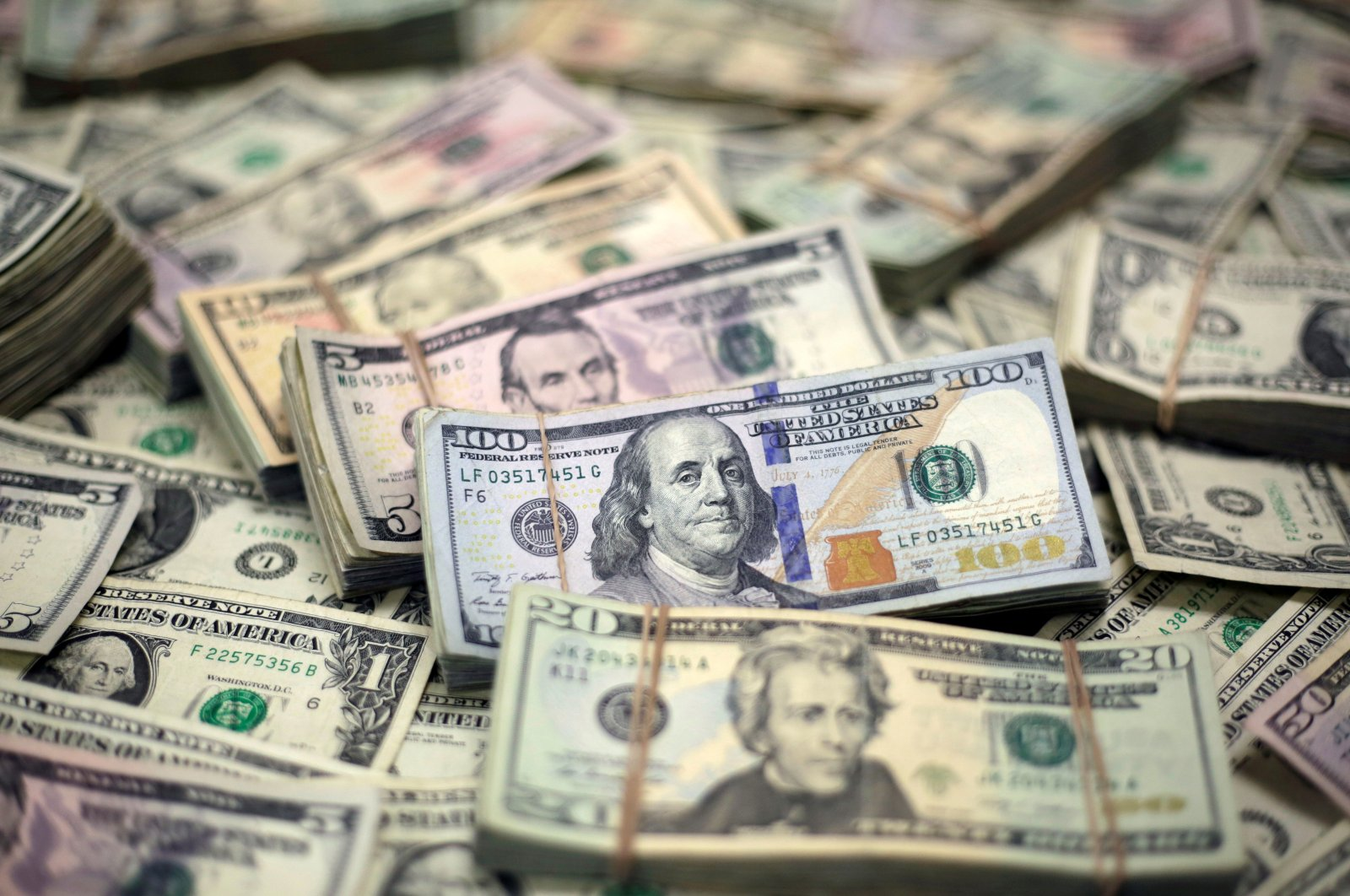 U.S. dollar banknotes are seen in this photo illustration taken Feb. 12, 2018. (Reuters Photo)