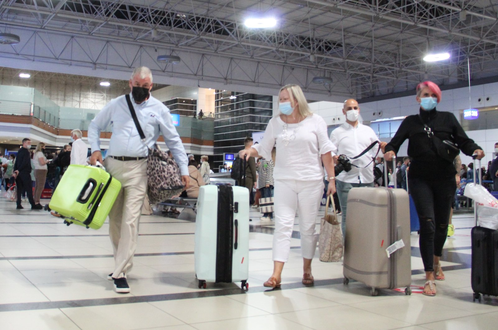 British tourists arrive at an airport in the southern resort city of Antalya, Turkey, Sept. 23, 2021. (IHA Photo)