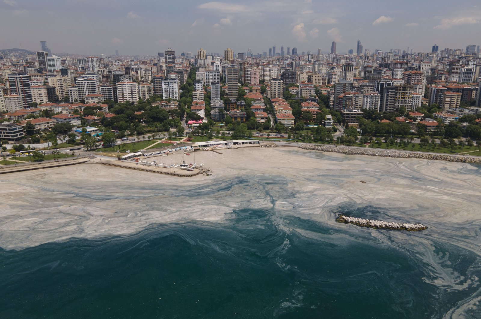An aerial photo of the sea at the Caddebostan shore with a visible huge mass of marine mucilage, or sea snot, on the Asian side of Istanbul, Turkey, June 7, 2021. (AP Photo)