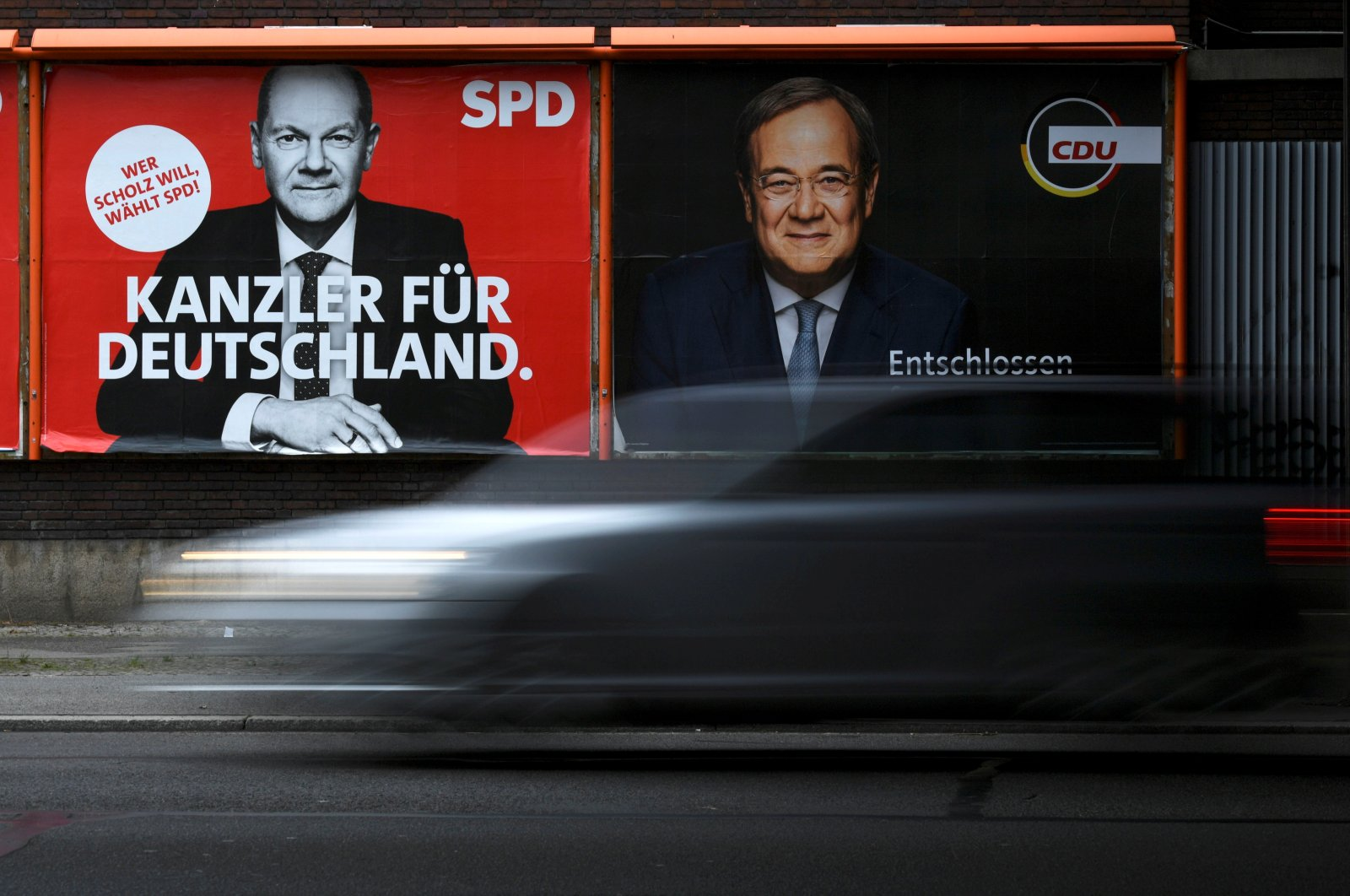 An election campaign billboard, featuring the top candidates for chancellor, Social Democratic Party's (SPD) Olaf Scholz and Christian Democratic Union's (CDU) Armin Laschet, is pictured on a street in Berlin, Germany, Sept. 23, 2021.  (Reuters Photo)