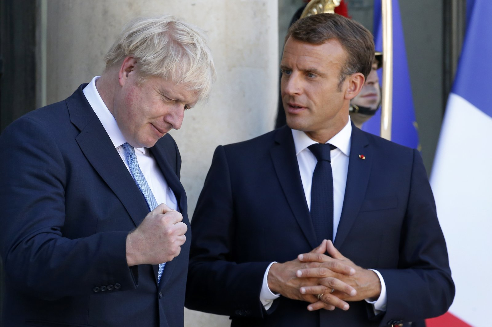 French President Emmanuel Macron accompanies British Prime Minister Boris Johnson after their meeting on Brexit at the Elysee Presidential Palace on August 22, 2019 in Paris, France. (Getty Images)
