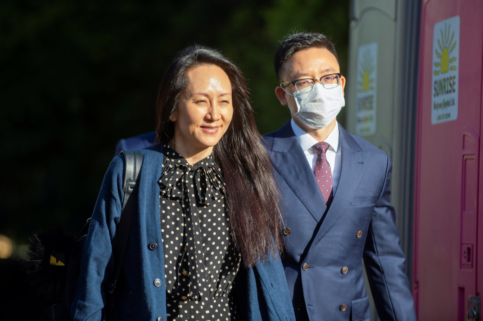 Huawei Technologies Chief Financial Officer Meng Wanzhou (L) leaves her home to attend a court hearing in Vancouver, British Columbia, Canada Sept. 24, 2021. (Reuters Photo)