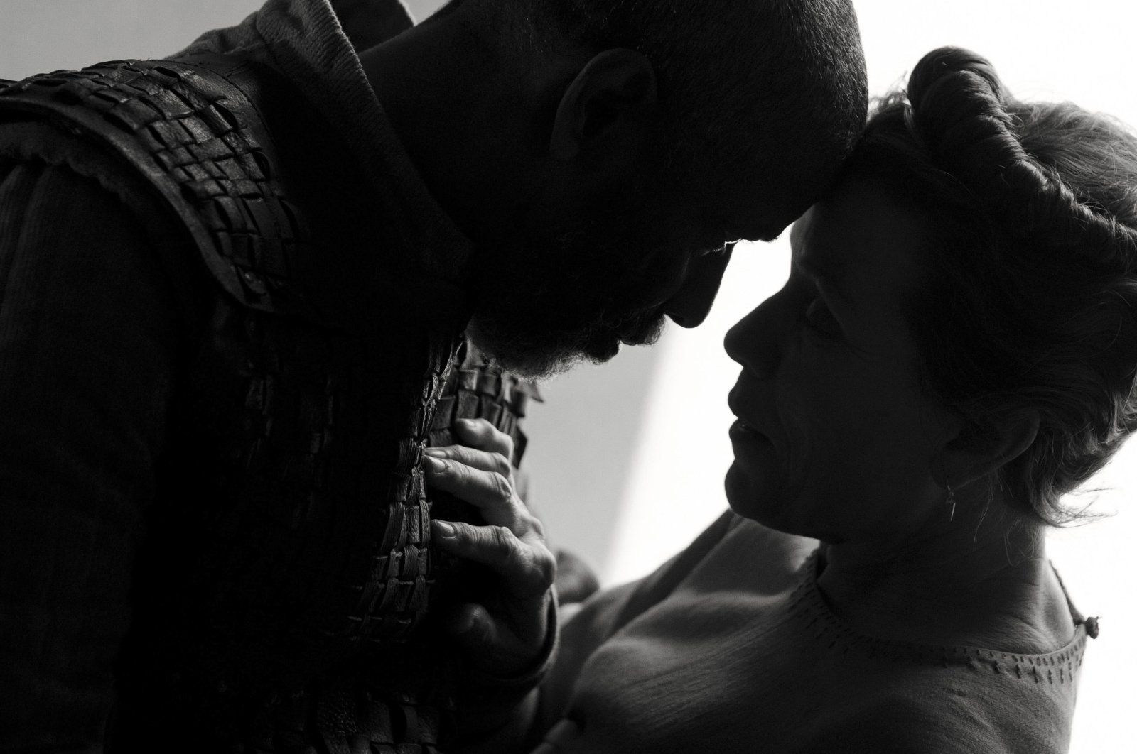 """Denzel Washington (L), and Frances McDormand, in a scene from the film """"The Tragedy of Macbeth."""" (Apple via AP)"""