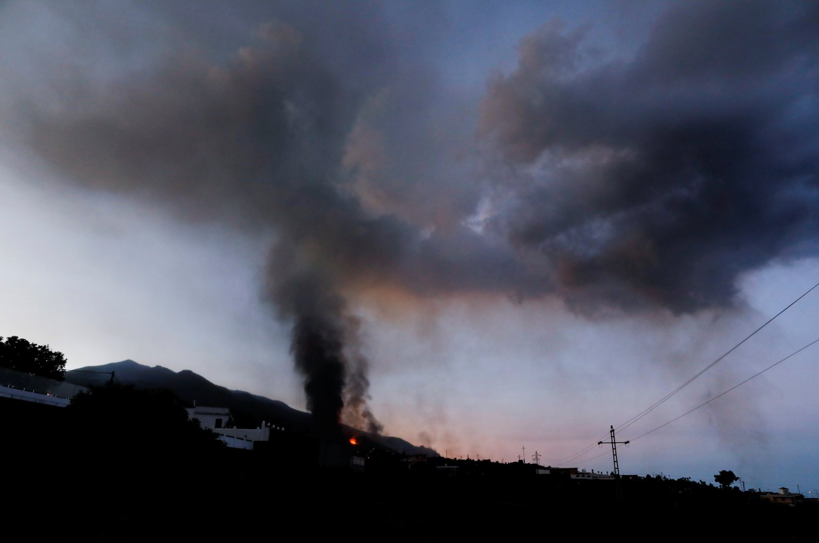 Lava and smoke rise at dawn following the eruption of a volcano on the Canary Island of La Palma, in El Paso, Spain, Sept. 25, 2021. (Reuters Photo)