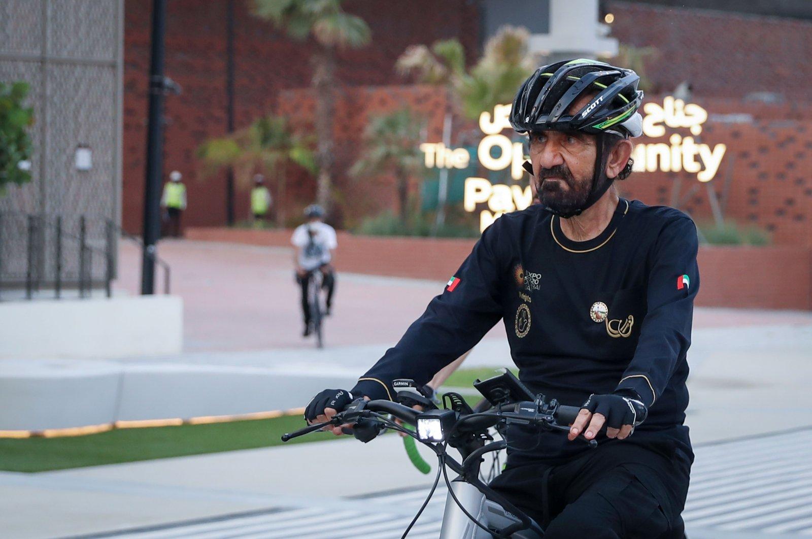 Prime Minister of the United Arab Emirates and ruler of Dubai, Sheikh Mohammed bin Rashid al-Maktoum cycles through the Dubai Expo 2020 site in Dubai, United Arab Emirates, Sept. 11, 2021. (Reuters Photo)